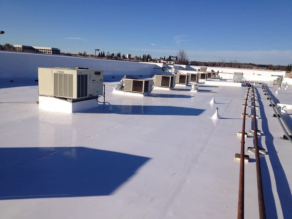 Commercial roof replacement KC Parkville Gladstone Liberty North KC Downtown River Market Midtown/Crossroads Westport Crown Center Brookside Country Club Plaza Waldo Raytown Independence Blue Springs Lee's Summit Grandview